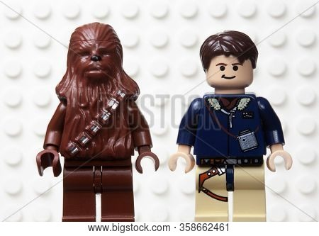 MARCH 30 2020 - Lego style mini figure of Han Solo and the Wookiee sidekick Chewbacca against a white Lego board