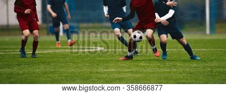 Horizontal Picture Of Soccer Match. Soccer Football Players Competing For Ball And Kick Ball During