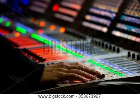 Sound Engineer Controls The Settings Of Mixing Console