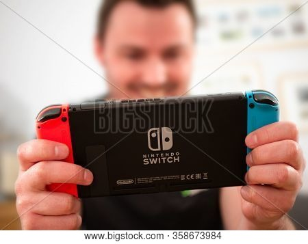 Uk, March 2020: Nintendo Switch Games Console Happy Player Enjoying Gaming