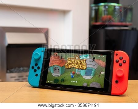 Uk, March 2020: Nintendo Switch Games Console Animal Crossing New Horizons Loading Page