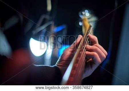 Guitarist playing the electric guitar on stage