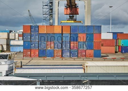 Cargo containers loaded on ships in a container terminal in Rotterdam