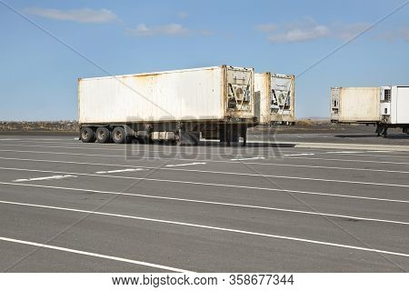 Cargo containers in truck trailers in a parking lot in Iceland