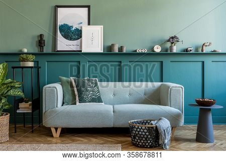 Stylish Interior Of Living Room With Mint Sofa, Design Furnitures And Elegant Interior Accessories.