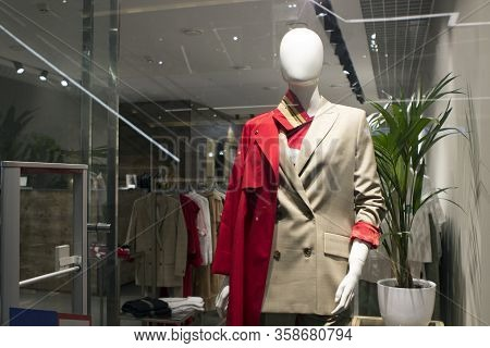 One Figure Of A Female Bald Mannequin Dressed In Spring, Summer Bright Business-style Clothes. Showc