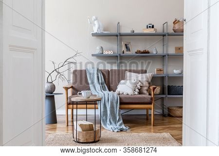 Modern Interior Design Of Living Room With Brown Wooden Sofa, Grey Bookstand And Elegant Interior Ac
