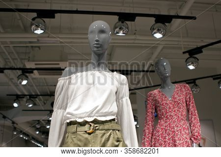 Two Figures Of Female Bald Mannequins Dressed In Spring, Summer Bright Clothes. Womens Clothing Stor