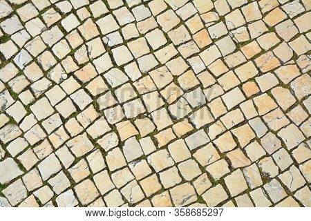 Typical Lisbon Pavement Made Of Limestone Squares Background.