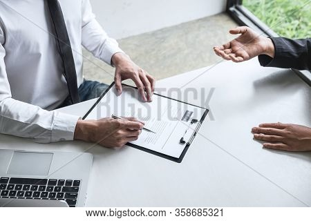Employer Or Committee Holding Reading A Resume With Talking During About His Profile Of Candidate, E