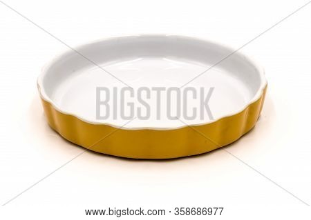 Orange Flat Porcelain Ramekin On A White Background