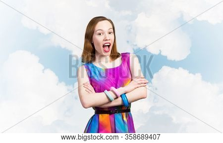 Beautiful Caucasian Woman Standing With Folded Arms. Elegant Fashionable Lady In Colorful Dress And