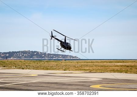 A Helicopter On, Over The Landing Site For Helicopters, Helicopters For Passenger Transportation
