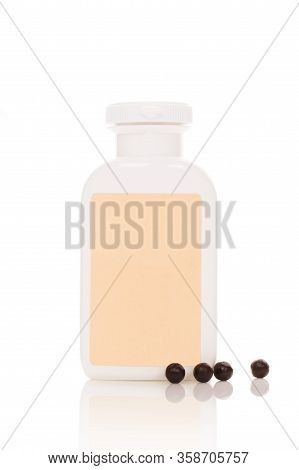 Chinese Herbal Patent Medicine In Bottle And Pills Isolated On White Background. Tcm Concept.