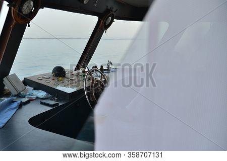 Close View Into Captains Cabins, Navigation Equipment. The Steering Wheel In The Ship. Captains Cabi