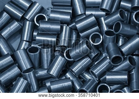 The  Pile Of Machined Tubes After Turning Process In The Container Box. Hi-technology Metal Working