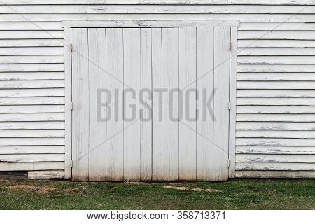 Faded White Wooden Warehouse Building Doorway Grass