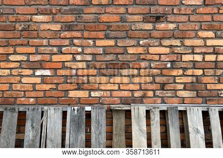 Vintage Old Red Brick Wall Leaning Weathered Pallets