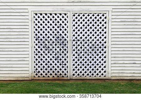 White Factory Building Barn Lattice Wood Door Grass