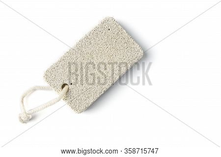 A Piece Of Pumice With A Rope In The Background