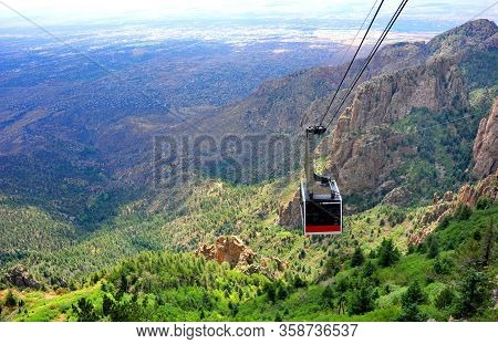 Sandia Tram Slowly Ascends From The Base Of The Sandia Mountains To The Crest. Vista Of Mountain And