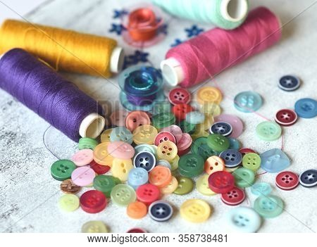 Sewing Accessories And Accessories For Needlework. Reels Of Thread, Pins, Buttons, Ribbons On White