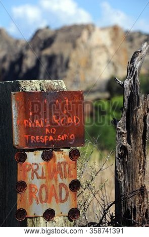 These Signs Are Very Emphatic, Keep Out, Private Road And No Trespassing.  Rustic Signs Are Posted O