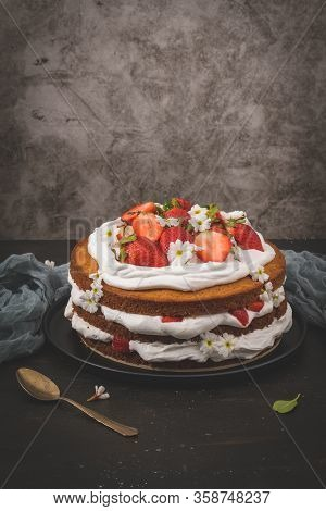 Strawberry Cake, Strawberry Sponge Cake With Fresh Strawberries And Sour Cream On A Dark Kitchen Cou