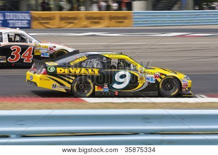 WATKINS GLEN, NY - AUG 12, 2012:  Marcos Ambrose (9) brings his car through the turns during the Finger Lakes 355 race at the Watkins Glen International in Watkins Glen, NY on Aug 12, 2012.