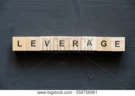 Modern Business Buzzword - Leverage. Top View On Wooden Table With Blocks. Top View. Close Up.