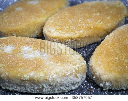 Fish Cutlets In A Pan Close-up. The Breading On The Rissole Became Ruddy. Background With Freshly Co