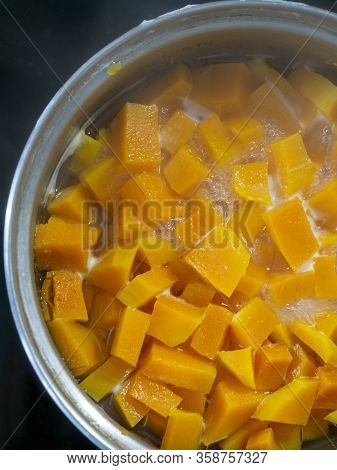 Pieces Of Pumpkin Are Stewed In A Small Amount Of Water. Part Of The Pumpkin Is Less Visible Due To