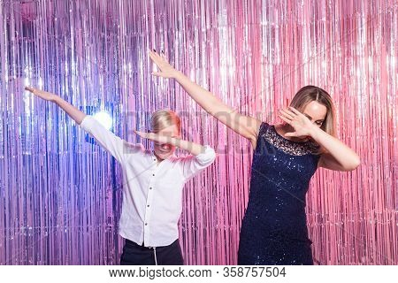 Fun, Mothers Day, Children And Family Concept - Teen Boy And His Mom Funny Dancing Shiny Party Backg