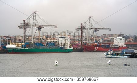 Leixoes, Portugal - February 1, 2020: Two Containerships At The Port Of Leixoes On An Overcast Day O