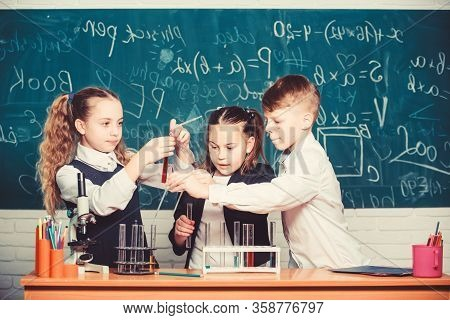 Students Do Biology Experiments With Microscope. Chemistry Microscope. Lab Microscope. Childrens Day