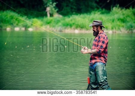 Bearded Fisher. Man Fishing. Perfect Weekend. Fishing Skills. Fisher Fishing Equipment. Active Sunny