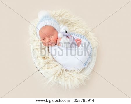 Charming wrapped up newborn lying awake