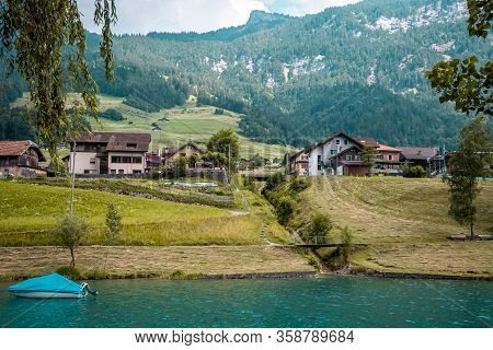 View Over The Lake Lungern. Lungernsee Is A Natural Lake In Obwalden