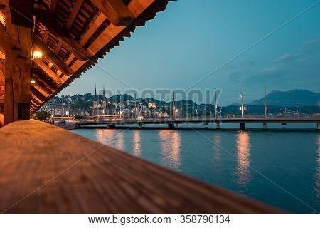 Kapellbrucke Historic Wooden Bridge In Luzern And Cityscape, Town In Central Switzerland.