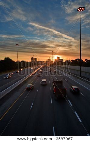 Commuters Trying To Beat The Traffic At Sunset
