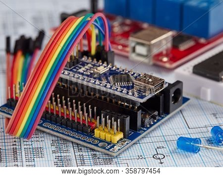 Arduino And Programmers With Peripherals And Expansion Boards Lie On A Gray Background. Do It Yourse
