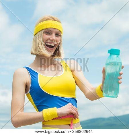 Fitness Woman. Healthy Sports Lifestyle. Athletic Young Woman In Sports Dress Doing Fitness Exercise