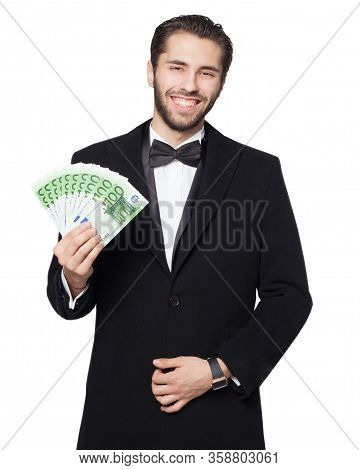 Shark Of Capitalism. Young Male Businessman Is Happy Showing Euro Money. Dressed In A Black Suit Wit
