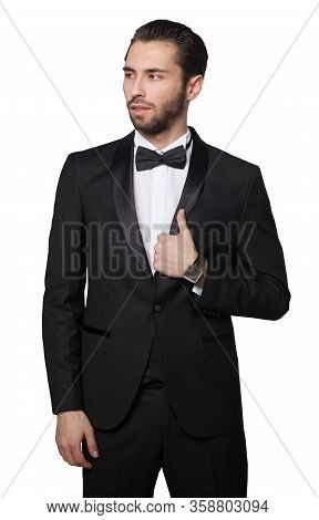 Shark Of Capitalism. Young Male Businessman Showing. He Is Dressed In A Strict Black Suit. Rich.