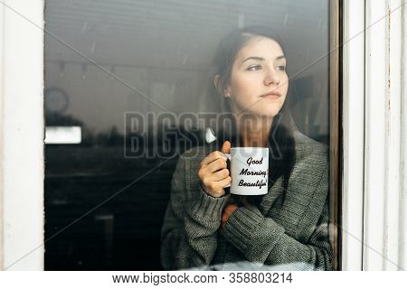 Young Woman Staying At Home Drinking Coffee/tea,looking Trough The Window.starting The Day,morning R