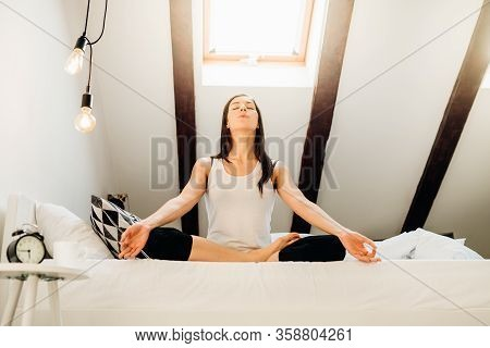 Woman Meditating In Bedroom At Home.antistress Practice.overcoming Anxiety And Fear.mindfullness Med