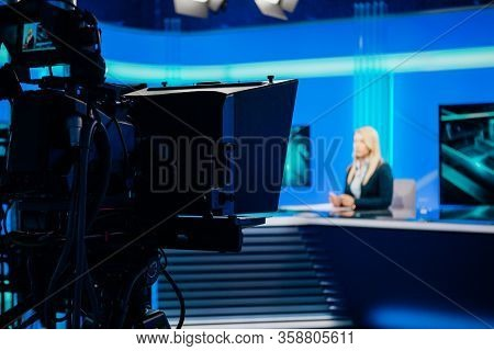 Recording At Tv News Studio Positioned Camera Equipment With Television Presenter Journalist Reporti