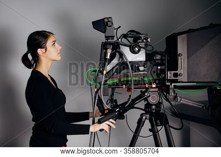 Recording Show At Tv Studio.professional Camera Operator With Camera In Television News Broadcast.ca