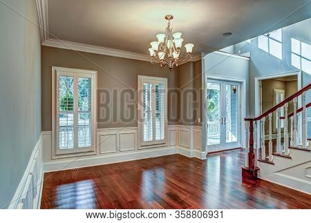 Unfurnished dining room interior in expensive house.