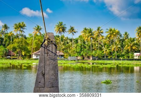 The Bow Of A Houseboat Moving To The Shore In The Backwaters. From Kerala India.